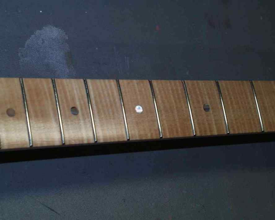 Lacquered Fretboard