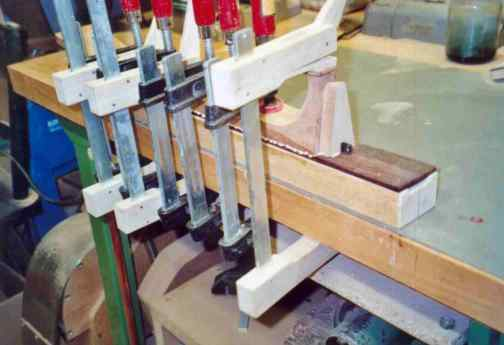 Gluing of the fingerboard